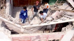 Residents remove rubble in search of survivors in a damaged house in Bantul, Yogyakarta, Central Java, Indonesia, Saturday, May 27, 2006. (AP / Susetyo Nugroho)