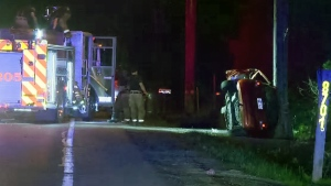 A hatchback rolled into a hydro pole after midnight in Terrebonne (CTV Montreal/Cosmo Santamaria)