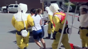 Emergency workers and actors run through a disaster simulation at the Montreal General Hospital on May 26, 2016