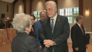 Quebec Premier Philippe Couillard greets Sheila Goldbloom, wife of the late Victor Goldbloom, at a gala in their family's honour on Thursday.