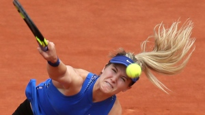 Canada's Eugenie Bouchard serves in her second round match of the French Open tennis tournament against Timea Bacsinszky of Switzerland at the Roland Garros stadium in Paris, France, Thursday, May 26, 2016. (AP Photo/David Vincent)