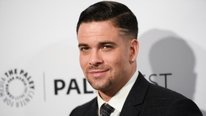 "Mark Salling arrives at the 32nd Annual Paleyfest ""Glee"" held at The Dolby Theatre in Los Angeles on March 13, 2015. (Photo by Richard Shotwell/Invision/AP, File)"