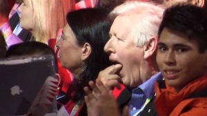 Former interim Liberal leader Bob Rae is shown in this still image taken from video from the 2016 Liberal Biennial Convention Winnipeg Saturday, May 28, 2016. Prime Minister Justin Trudeau offered rare praise Saturday for Conservative predecessor Stephen Harper but at least one Liberal elder statesman found it a bit hard to swallow. Rae was caught on video sticking two fingers in his mouth, pretending to gag. THE CANADIAN PRESS