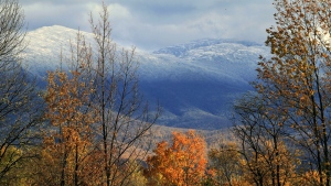 The snow covered peak of Mount Washington is seen, Thursday, Oct. 11, 2012 in this photo taken from Jefferson, N.H. (AP / Jim Cole)