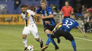 Montreal Impact's Kyle Fisher, centre, and Lucas Ontiver (32) challenge LA Galaxy's Sebastian Lletget during second half MLS soccer action in Montreal, Saturday, May 28, 2016. THE CANADIAN PRESS/Graham Hughes