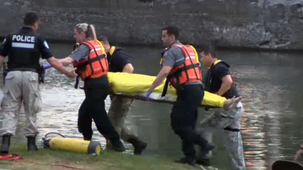 Rescue workers pull a body out of the Lachine Canal around 8:30 p.m. Sunday May 29, 2016