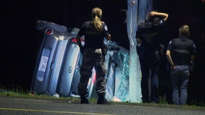 Police examine the wreckage of a Kia Soul that smashed into several concrete blocks in Baie D'Urfé on May 30, 2016 (CTV Montreal/Cosmo Santamaria)