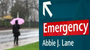An unidentified woman heads past the Halifax Infirmary in Halifax on Tuesday, April 24, 2012. (Andrew Vaughan / THE CANADIAN PRESS)