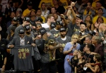 Cleveland Cavaliers forward LeBron James, bottom center, celebrates with teammates after Game 7 of basketball's NBA Finals against the Golden State Warriors in Oakland, Calif., Sunday, June 19, 2016. The Cavaliers won 93-89. (AP Photo/Eric Risberg)