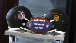 NFL and Cirque du Soleil helmets and a commemorative football are displayed at a joint press conference to announce the NFL Experience Times Square, a new interactive exhibit opening in Fall 2017, on Thursday, June 23, 2016, at The Renaissance Hotel in New York. (Andy Kropa / AP Images for Cirque du Soleil)