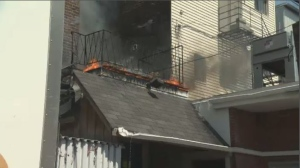 The fire started on a second-floor balcony behind the store.