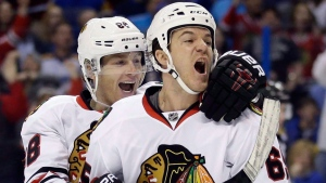 Chicago Blackhawks' Andrew Shaw, right, is congratulated by teammate Patrick Kane after scoring during NHL hockey first-round Stanley Cup playoff action against the St. Louis Blues, Friday, April 15, 2016, in St. Louis. The Montreal Canadiens added forward Andrew Shaw in a draft-day deal with the Chicago Blackhawks. THE CANADIAN PRESS/AP, Jeff Roberson