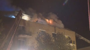 Over 70 firefighters responded to an apartment building fire in Greenfield Park that started early Monday morning.