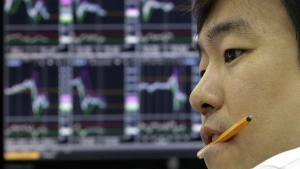 A currency trader monitors a foreign exchange dealing room of the KEB Hana Bank headquarters in Seoul, South Korea on Monday, June 27, 2016. (AP / Ahn Young-joon)