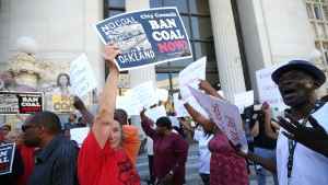 Pro-coal demonstrators face off against anti-coal opponents in front of City Hall before a special council meeting on the shipping and storage of coal in Oakland, Calif. on Monday, June 27, 2016. (Aric Crabb / Oakland Tribune)