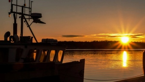 A sunset is shown in Mahone Bay, N.S. (Lloyd Westhave / Oakland via Town of Mahone Bay)