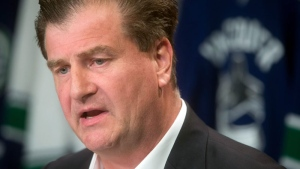 Vancouver Canucks general manager Jim Benning speaks during an NHL hockey news conference in Vancouver, on Sept. 17, 2015.  (Darryl Dyck/The Canadian Press via AP)