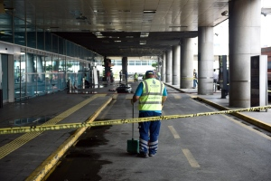 A worker cleans at an entrance of Ataturk Airport in Istanbul, Wednesday, June 29, 2016. (AP Photo)