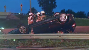 The car flipped over the guardrail and came to a stop on the grass between Highway 132 and the service road in Brossard