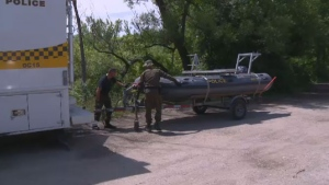 Surete du Quebec police divers are involved in the search for a missing 20-year-old man who disappeared while out with family and friends near the Pointe des Cascades canal.