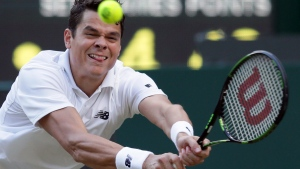 Milos Raonic of Canada returns to Jack Sock of the U.S during their men's singles match on day six of the Wimbledon Tennis Championships in London, Saturday, July 2, 2016. (Tim Ireland/AP Photo)