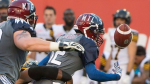 Montreal Alouettes quarterback Rakeem Cato fumbles the ball during first half CFL football action in Montreal on Friday, July 15, 2016. THE CANADIAN PRESS/Peter McCabe