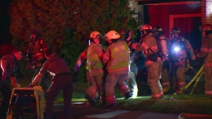 Firefighters at the scene of a fire in Longueuil that claimed the life of one man.