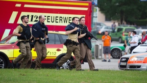 Policemen arrive at a shopping centre in which a shooting was reported in Munich, southern Germany, Friday, July 22, 2016. (Matthias Balk / dpa via AP)