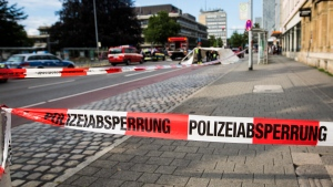 Police have cordoned off an area in inner city Reutlingen, Germany, Sunday, July 24, 2016. A man killed a woman with a machete and injured two other people in the area. (CHRISTOPH SCHMIDT/dpa via AP)