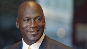 Former NBA star and current owner of the Charlotte Hornets, Michael Jordan, smiles at reporters in Chicago on Aug. 21, 2015. (AP / Charles Rex Arbogast)
