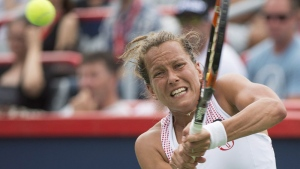 Barbora Strycova from the Czech Republic returns to Caroline Garcia from France during their round one match at the Rogers Cup tennis tournament in Montreal, Monday, July 25, 2016. THE CANADIAN PRESS/Graham Hughes