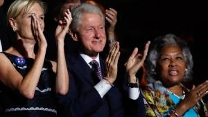 Former President Bill Clinton applauds Bernie Sanders at the Democratic National Convention in Philadelphia, on July 25, 2016. (Paul Sancya / AP)