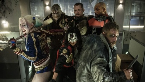 """In this image released by Warner Bros. Entertainment, cast members, clockwise from left, Margot Robbie, Adewale Akinnuoye-Agbaje, Joel Kinnaman, Will Smith, Jai Courtney and Karen Fukuhara appear in the film, """"Suicide Squad."""" This week's Comic-Con is expected to draw more than 160,000 fans for high-energy sessions featuring casts and crews from such films and TV shows as """"Game of Thrones,"""" """"Star Trek,"""" """"Suicide Squad,"""" """"South Park,"""" """"Teen Wolf,"""" """"Aliens"""" and """"The Walking Dead.""""(Clay Enos/Warner Bros. Entertainment via AP)"""
