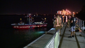 At least one person is missing after a pleasure boat collided with a docked container ship in the Port of Montreal on Tuesday night. (Photo: CTV Montreal/Cosmo Santamaria)