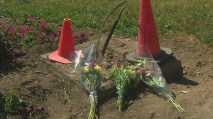 Flowers have been laid at the scene in Caledon where a vehicle collided with a brick structure killing a 12-year-old girl.