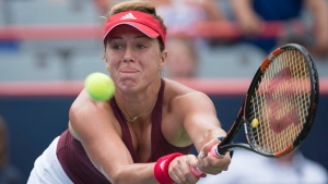 Anastasia Pavlyuchenkova of Russia lunges to return to Agnieszka Radwanska of Poland during third round of play at the Rogers Cup tennis tournament Thursday July 28, 2016 in Montreal. THE CANADIAN PRESS/Paul Chiasson