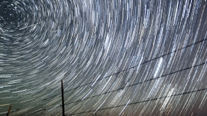 Perseid meteors, upper left, streak past time-lapse-captured stars early Tuesday morning, Aug. 13, 2013 north of Cheyenne , Wyo. The Perseids meteor shower runs from mid-July through mid-August. (AP Photo / The Wyoming Tribune Eagle, Blaine McCartney, File)
