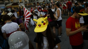 Spanish fans play the highly addictive Pokemon Go game during a gathering in central Madrid, Spain, on Thursday, July 28, 2016. (AP / Daniel Ochoa de Olza)