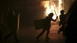 Riot police run to confront anti-government protesters, supporters of the armed group who have been holed inside a police station, clash with police in Yerevan, Armenia on Friday, July 29, 2016. (Aram Kirakosyan / PAN Photo)