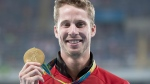 Canada's Derek Drouin shows off his gold medal for high jump at the Olympic games in Rio de Janeiro, Brazil, Wednesday, Aug.17, 2016. (Frank Gunn / THE CANADIAN PRESS)