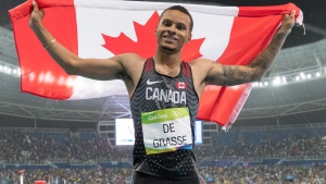 Canada's Andre De Grasse celebrates his silver medal performance in the 200-metre at the Olympic games in Rio de Janeiro, Brazil, Thursday August 18, 2016. THE CANADIAN PRESS/Frank Gunn