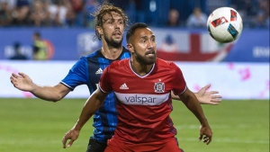 Montreal Impact's Marco Donadel, left, and Chicago Fire's Arturo Alvarez battle for the ball during second half MLS action in Montreal on Saturday, August 20, 2016. THE CANADIAN PRESS/Peter McCabe
