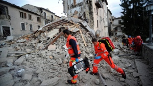 Rescuers search a crumbled building in Arcuata del Tronto, central Italy, where a 6.1 earthquake struck just after 3:30 a.m., Wednesday, Aug. 24, 2016. (AP / Sandro Perozzi)