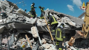 Firefighters search through debris of a collapsed building following an earthquake in Amatrice, central Italy, Wednesday, Aug. 24, 2016. (Italian Firefighters/AP)
