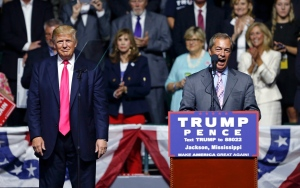 Nigel Farage, ex-leader of the British UKIP party, speaks as Republican presidential candidate Donald Trump, left, listens, at Trump's campaign rally in Jackson, Miss., Wednesday, Aug. 24, 2016. (AP / Gerald Herbert)