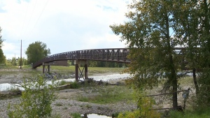 The footbridge leading to Woodhaven Drive in Okotoks, Alta. where a woman says she was assaulted by a group of 11 teenagers on the weekend.