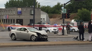A bystander is in critical condition after his vehicle was hit by a car driven by a man feeling the scene of a shooting in St-Michel. (Photo: CTV Montreal/Christophe Terrade)