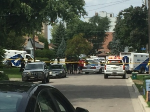 Police and paramedics at the scene of an apparent crossbow attack in Toronto on Thursday, Aug. 25, 2016. (Natalie Johnson / CTV News)