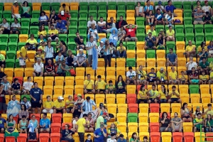 Spectators take their seats at the handball venue ahead of the the men's preliminary handball match between Denmark and Argentina at the 2016 Summer Games in Rio de Janeiro, Brazil on August 7, 2016. (THE CANADIAN PRESS/AP, Matthias Schrader)