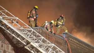 Firefighters on the roof of an apartment building in Verdun on Aug. 31, 2016